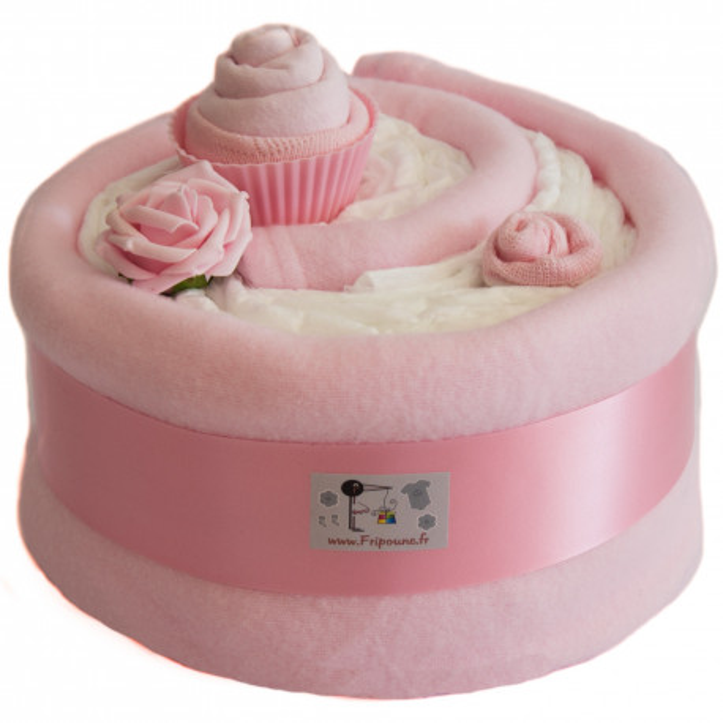 Gâteau de couches et couverture rose
